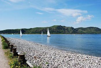 View of Foot/cycle path to Conwy, close to Lymehurst B&B Llandudno. Sail boats with Conwy Mountain in background.